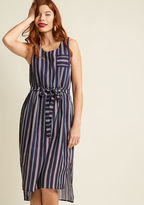 23867D As you stand atop the dock, letting the ocean breeze billow your navy midi dress, you exemplify nautical bliss! A day on the water with a glass of bubbly in hand is made all the more marvelous with this frock's chest pocket, buttoned back, and Americana s