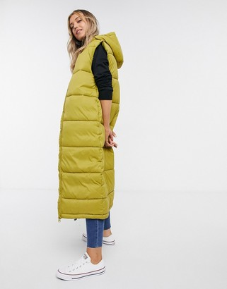 Monki Lizz recycled sleeveless long padded jacket in olive