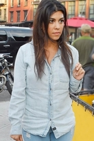 kourtney kardashian  Who made  Kourtney Kardashians black hat, denim shirt, gray backpack, and suede ankle boots?
