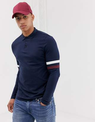 Asos Design DESIGN organic long sleeve polo shirt with contrast sleeve stripe in navy