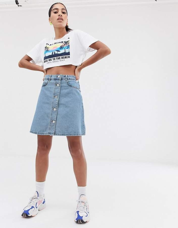 button through front blue mini skirt