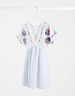 En Creme smock dress with ladder inserts and floral embroidery