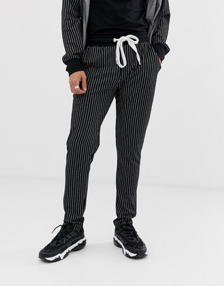 Criminal Damage skinny jogger in black with pin stripe