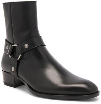 Saint Laurent Leather Wyatt Harness Boots in Black | FWRD