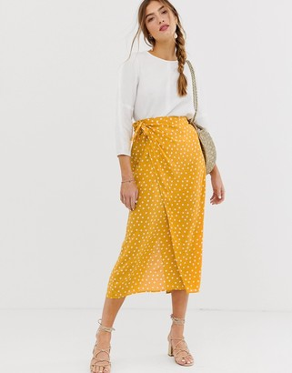 Asos DESIGN wrap maxi skirt with tie front in yellow polka dot