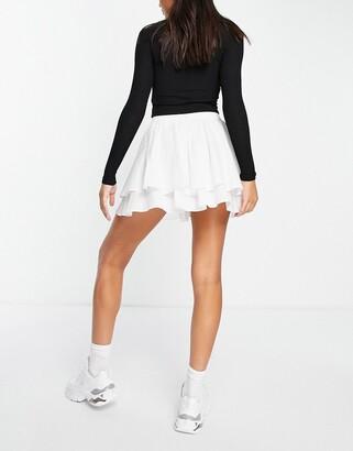 Weekday Kate organic cotton tiered mini skirt in white
