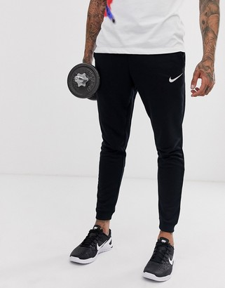 Nike Training tapered fleece pants in black