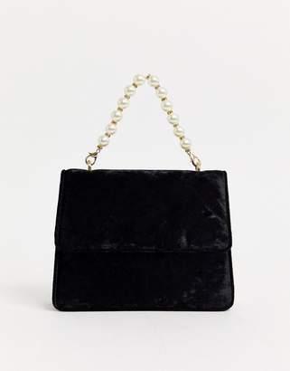 Liars & Lovers black velvet bag with pearl handle detail