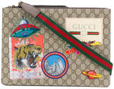 Gucci Embellished GG Supreme clutch bag