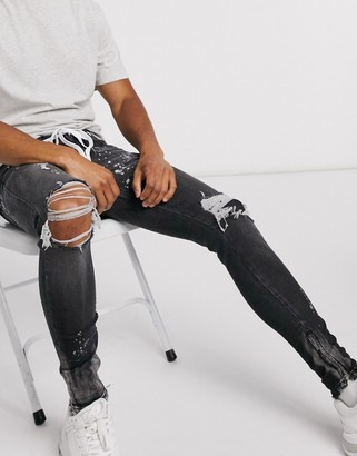 The Couture Club rip n repair bleached jeans in black