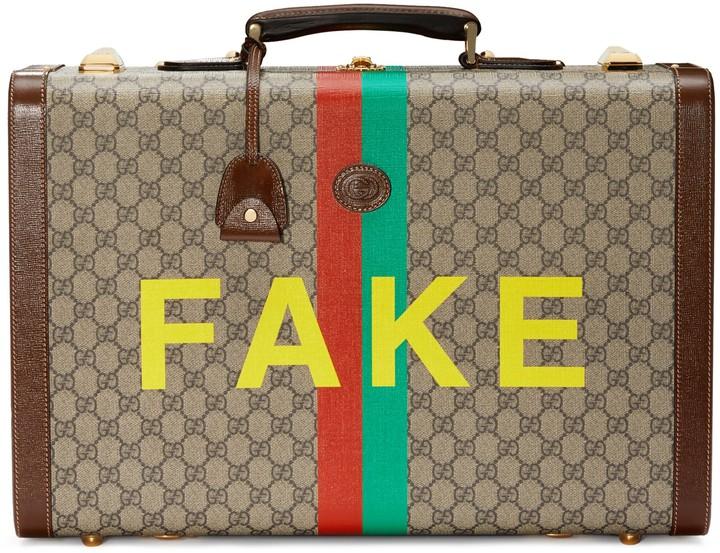 Gucci 'Fake/Not' print medium suitcase