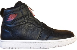 Jordan Air 1 Black Leather Trainers