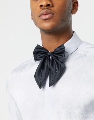 ASOS DESIGN oversized satin bow tie in black with embellishment