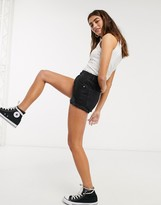 Asos Design DESIGN denim mid rise relaxed ripped shorts in black
