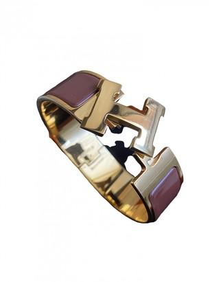 Hermã ̈S HermAs Clic H Burgundy gold and steel Bracelets