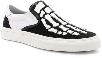 Amiri Slip On Bones Sneaker in Black & White | FWRD