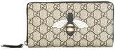 Gucci bee print GG Supreme wallet - men - Polyurethane - One Size