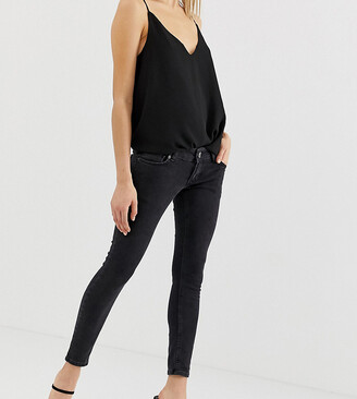 Asos DESIGN Petite extreme low rise skinny jeans in washed black