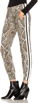 Norma Kamali Side Stripe Jog Pant in Scale Python & Offset Stripe | FWRD