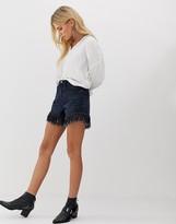 Blank NYC fringe hem denim shorts