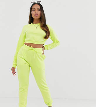 Asos DESIGN Petite tracksuit cropped sweat / slim jogger with tie in neon yellow