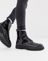 Asos Design DESIGN lace up brogue boots in black faux leather on chunky sole