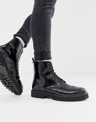 Asos DESIGN lace up brogue boots in black faux leather on chunky sole
