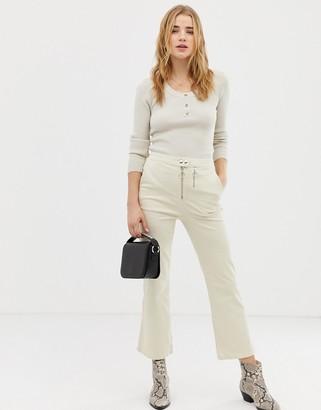 ASOS DESIGN kick flare trouser with double zip in bone