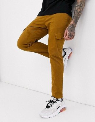 Asos Design DESIGN skinny ankle grazer cargo trousers with slanted pockets in tan-Brown