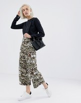Asos Design DESIGN cropped wide leg pants with belt in camo animal