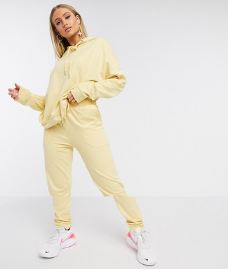 ASOS DESIGN tracksuit hoodie / slim jogger with tie in organic cotton in washed yellow
