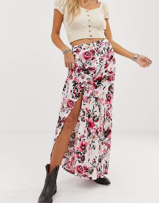 En Creme maxi skirt with button front detail in floral
