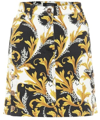 Versace Acanthus printed denim miniskirt