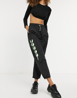Puma evide woven track pant in black
