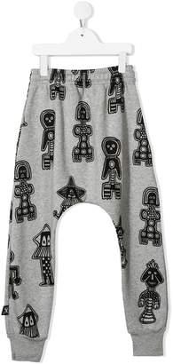 Nununu Tribal Dancers print casual trousers