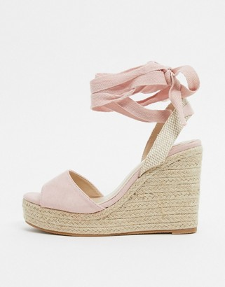 Glamorous espadrille wedge sandal with ankle tie in blush pink