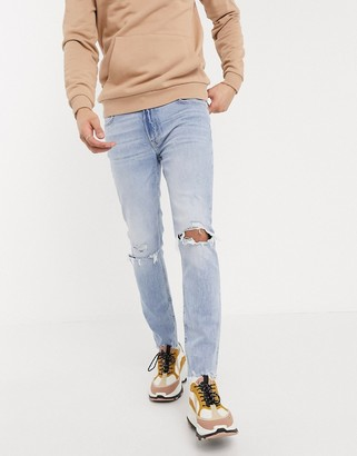 Bershka skinny jeans with knee rips in light blue wash