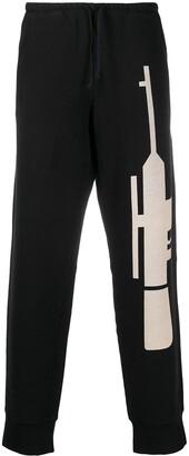 Walter Van Beirendonck Pre-Owned Gun-print track pants