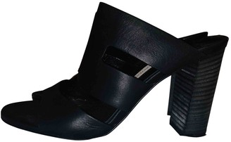 Diane von Furstenberg Black Leather Mules & Clogs