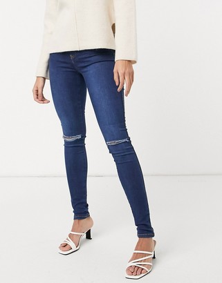 Dr. Denim Plenty skinny jeans with ripped knee in blue
