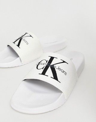 Calvin Klein Chantal white canvas sliders