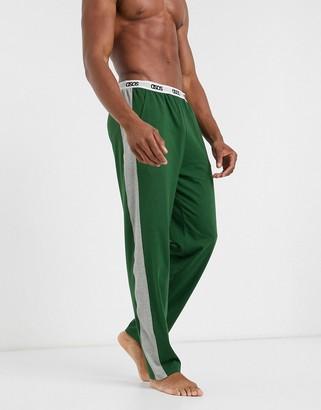 ASOS DESIGN lounge pyjama bottoms in khaki with gray marl side panels