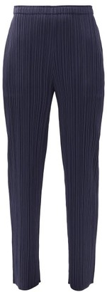 Pleats Please Issey Miyake High-rise Technical-pleated Tapered Trousers - Navy