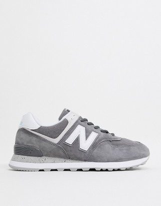 New Balance 574 trainers in grey and black suede