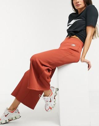 Nike ribbed high waist wide leg sweatpants in rust