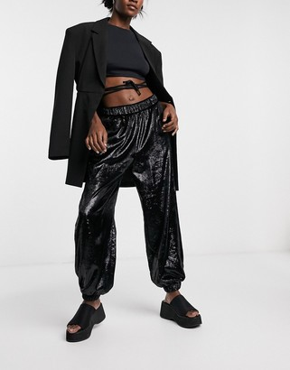Love Moschino sequin track pants in black