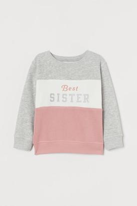 H&M Sibling sweatshirt