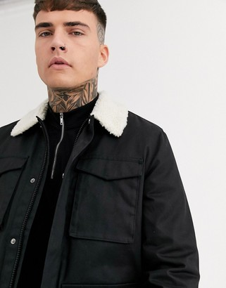 Asos DESIGN jacket with wax finish and fleece collar in black