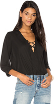 Krisa Lace Up Surplice Blouse
