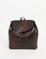 Asos Design DESIGN mini soft minimal backpack in snake